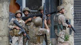 الجيش اللبناني يحقق مع عسكري يشتبه في إطلاقه النار تجاه المتظاهرين